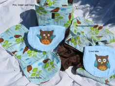 Owl baby gift set, minky blanket, 2 burp cloths, 2 bibs, Wet -PUL lined- tote bag, diaper wet bag baby to toddler gift set., via Etsy.