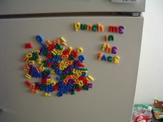 and THIS is why we no longer have Alphabet Magnets on our fridge!