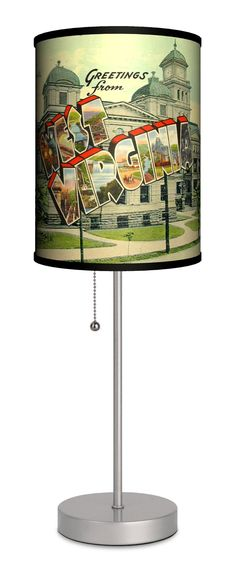 Travel - West Virginia Postcard Sport Silver Lamp. All shades printed and made in USA. State of the art translucent shade material with non-fade inks. Ultra-durable, powder-coated silver finish base with pull-chain. Stylish gift box with carrying handle. Suggested 13-watt CFL bulb.