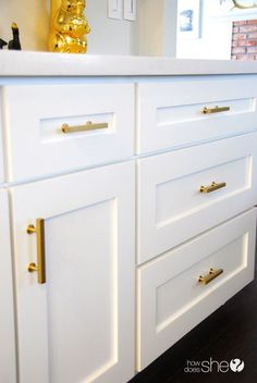 making ikea pax look good brushed gold handles by www knobs com