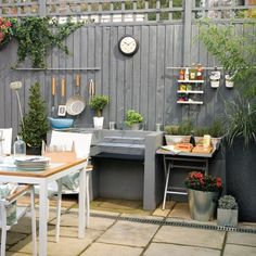 Garden with grey painted fence and cooking station