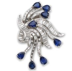 A diamond and sapphire brooch  the cascade style brooch, channel-set with baguette-cut diamonds, terminating with pear-shaped sapphires; estimated total diamond weight: 6.50 carats; mounted in platinum; length: 2 1/4in.