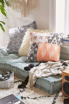 I'm in love with these floor cushions for the lower level. $149 from Urban Outfitters. Come in several colors.  Magical Thinking Rohini Daybed Cushion
