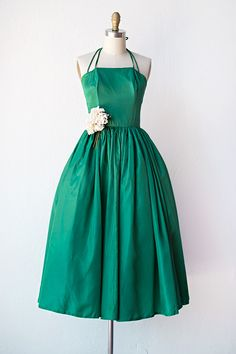 """VINTAGE 1950S EMERALD GREEN HALTER PARTY DRESS //  Name:Beyond Provence Dress   silk blend. This dress has thin adjustable double straps that tie behind the neck. It features a boned bodice with a straight across neckline. The waist is fitted and sits at the natural waist line. ruching at the waist that gives the full skirt a lot of height and body. There is a zipper closure at the back center bodice. 30"""" bust x 10"""" bodice x 24"""" waist x 42"""" length    size 