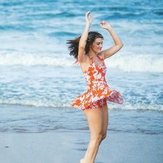 Marie in Tangerine swimdress.  www.reyswimwear.com Who says it has to be itsy bitsy?