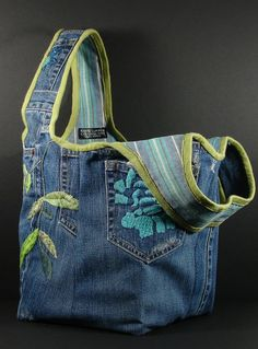 What do you do with a pair of skillfully embroidered blue jeans you cant wear anymore? How about recycling into this one-of-a-kind tote? A bag that