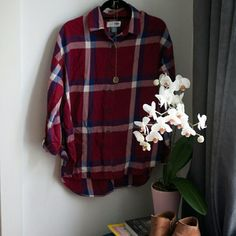 Old Navy Boyfriend Flannel Navy, white and burgundy button down flannel shirt. Worn a couple of times but in great condition from non-smoking home. So cute to wear with cut offs for the spring! Old Navy Tops Button Down Shirts