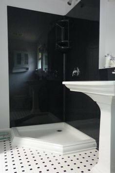 Black colored smooth solid surface shower wall panels in a corner shower - Innovate Building Solutions Budget Bathroom, Bathroom Wall Decor, Small Bathroom, Bathroom Remodeling, Bathroom Ideas, Remodeling Ideas, Master Bathroom, Bathroom Interior, Bath Ideas