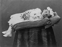 memento mori photo - most of the time they better close the eyes of the children, it makes them creepy and not nice to remember imho.