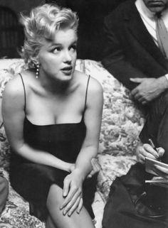 """Marilyn Monroe photographed by Earl Leaf, 1956."""