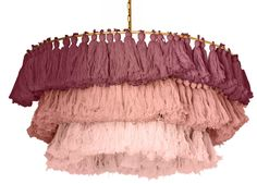 We're obsessed with this statement-making chandelier. Tiered fringe tassels with an ombre finish bring a true bohemian style to your space!