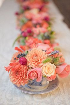 Orange, pinks, peach with some privet berry accents.