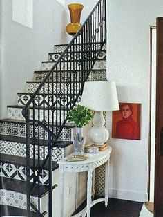 black and white patterns done on stair risers with tile.