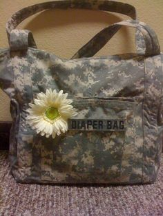 This is a diaper bag I made for my niece out of her hubby's uniforms. It turned out really cute! I added a flower pin which can be removed if she has a boy next time!