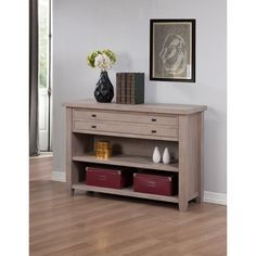 This Navigator Dove console table features two slim drawers for extra storage space. This elegant accent table is featured in a gorgeous grey finish that is sure to bring style and sophistication to your home decor.