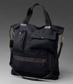 """""""multi-pocket urban tote"""" Smart-looking yet functional in commuter bag designs. An urban carry-all with a variety of pocket compartments for wallet, cellphone and PC notebook makes it the perfect e..."""