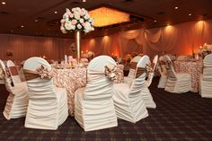 Liking these chair covers and the bows tied on the side instead of right behind. At The Mirage Elegant Banquets and Catering - Photo Gallery