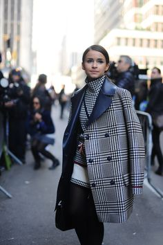 Miroslava Duma arrived at Calvin Klein, decked out in houndtooth print.