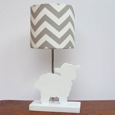 Decorate a gender-neutral nursery with a lamb or sheep theme cute lamb lamp