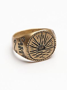 Ruskin Signet Ring | Made in New York City, this sterling silver ring features an intricately etched design on the oval face.