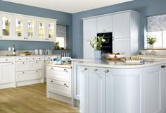Burbidge's Kemble Kitchen painted in Cornflower Blue and Ivory - Curved Doors and Glass Doors