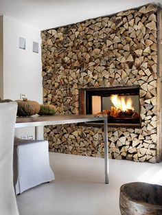 Fire place set into a rustic split log wall. If you like the effect, find… Timber Feature Wall, Feature Walls, Log Wall, Wood Logs, Interior Decorating, Interior Design, Decorating Tips, Into The Woods, Fireplace Design