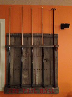 Reclaimed wood pool cue rack. used old bin wood and power pole pieces