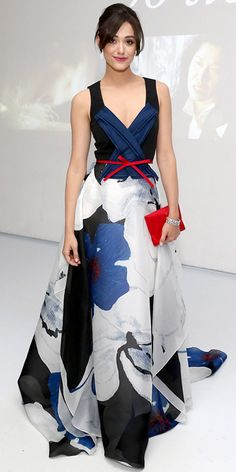 Carolina Herrera Dress/Gown worn by Emmy Rossum. White, Blue & Black Floral Motif Skirt with Red Bow Tie around Waist and Red Clutch.