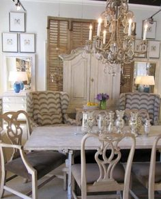 wing chairs, fabric,  small chests with mirrors in background. never thought for the dining room, would be good for linens and such