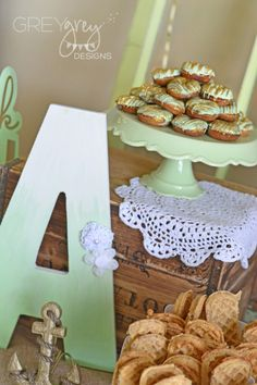 For a brunch baby shower, skip the cake and do a tower of beautifully glazed donuts and waffle sticks!