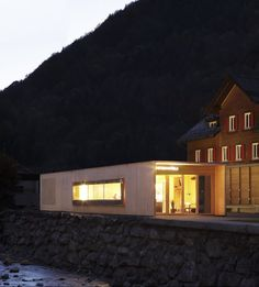 """The building casts a 'welcoming glow' in the evening."" Metzgerstüble, a bar and restaurant in the village of Mellau, Austria, designed by local architect Bernardo Bader."