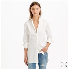 """J.Crew Endless shirt in white Hi! For sale is a J.Crew white Endless shirt, one of their popular items that it's sold out! It's has a long lean silhouette, feels so comfortable and fresh for any season. Purchased February 2015 and only wore once; has been dry cleaned after - basically brand new! So comfortable but it's just sitting in my closet   Cotton with a hint of stretch. Long sleeves with piqué cuffs. Machine wash. Item A9932. Body length: 31"""". J. Crew Tops Button Down Shirts"""