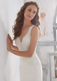 Morilee by Madeline Gardner 'Marquita' 5508 | A Fresh Take on a Classic Crepe Sheath Wedding Dress. Crystal Beaded Alençon Lace AppliquŽés Accent the Bodice and Open Keyhole Back. Colors Available: White, Ivory. Shown in Ivory.