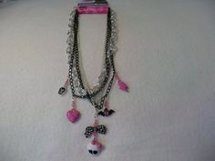 Monster High Skull & Bows Jewelry, Layered Multi Chain & Charms Necklace by Tween Brands, http://www.amazon.com/dp/B004C6LMP0/ref=cm_sw_r_pi_dp_FP3nqb0TE0V1N