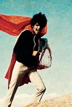 Hélio Oiticica. Singer and composer Caetano Veloso wearing P 04 Parangolé cape 1 (1964), 1968. Photograph. Courtesy of Yerba Buena Center for the Arts, San Francisco.