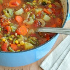 Loaded Vegetable Soup Recipe Soups with olive oil, carrots, celery, onions, garlic, green pepper, red pepper, broccoli, vine ripened tomatoes, fresh mushrooms, diced tomatoes, corn, frozen peas, green beans, potatoes, water, tomato paste, bay leaves, dried basil, sea salt, black pepper, crushed red pepper flakes