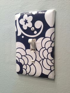 Cover lght switch and outlet covers with scrapbook/wrapping paper and mod podge