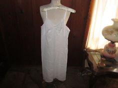 Vintage Lingerie Slip White Size 34 ERA 1970's. $6.50 USD, via Etsy.