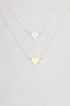 Geometric triangle gold and silver necklace. A hypoallergenic thin chain necklace.