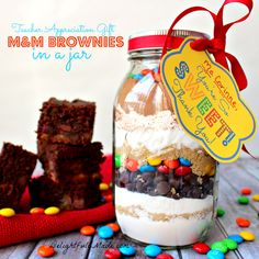 "Everyone loves brownies!! Why not give it as a gift? This easy M&M Brownie mix in a jar is the perfect ""Thank You"" gift for anyone in your life."