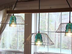 Lights made with insulators and vintage wire baskets! Electric Insulators, Insulator Lights, Glass Insulators, Copper Lighting, Unique Lighting, Lighting Ideas, Turn Around Bright Eyes, Vintage Wire Baskets, Automotive Furniture