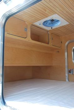 Upper storage cabinets at the foot of the bed