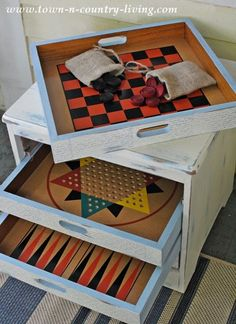 From Trash to Treasure Game Table - each games has it& own tray - - easier to contain all the pieces!