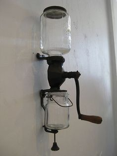 Antique Arcade wall mounted coffee grinder. On the hunt for one of these.