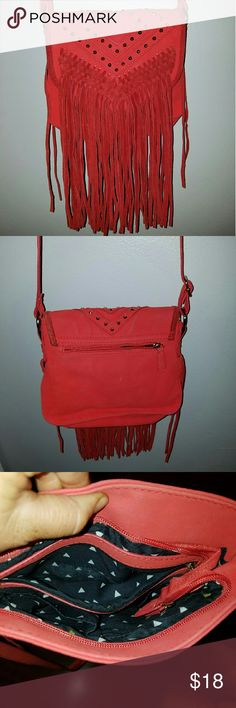 GORGEOUS RUST CROSSBODY W FRINGE Boho chic, trending cross body bag w/ fringe. Gold stud details and hardware. Pockets on back and inside. Measures 9 x 7. Excellent condition, but inside pocket there is a stain as shown. Sold as Bags Crossbody Bags