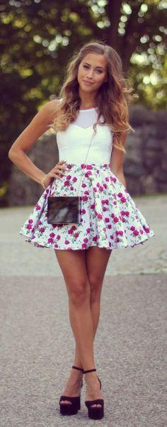 Shop this look on Lookastic:  https://lookastic.com/women/looks/cropped-top-skater-skirt-heeled-sandals-crossbody-bag-bracelet/11980  — White Mesh Cropped Top  — Dark Brown Leather Crossbody Bag  — Gold Bracelet  — White Floral Skater Skirt  — Black Suede Heeled Sandals