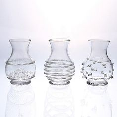 Juliska Mini Vases, Set of 3. Juliska glassware is mouth-blown by artisans in the hills of Prague. The unique composition of Juliska glass allows it to be blown especially thin, making the glass an unexpected pleasure to drink from and to handle. affiliate