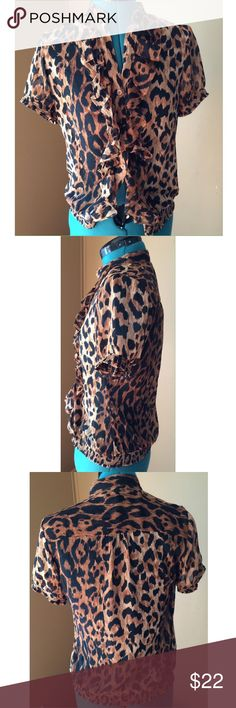 """🚨LAST CHANCE🚨Limited Leopard Sheer Ruffle Blouse Lightweight Leopard Print Short Sleeve Sheer Blouse from the limited.  Features an elastic band around the bottom hem for a bloused peasant fit, ruffles along the button line, and elastic around the sleeve caps for a fitted look in the arms. Condition: EUC - free of rips, stains, odors. Material: 100% Polyester - super lightweight. Size: SMALL Pit to Pit: 19"""" fully buttoned Length: 23"""" The Limited Tops Blouses"""
