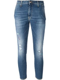 Blue cotton blend cropped skinny jeans from  People featuring a button and zip fly, whiskering at the thigh, belt loops and a five pocket design.