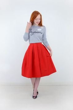 grey slogan sweater with red midi skirt